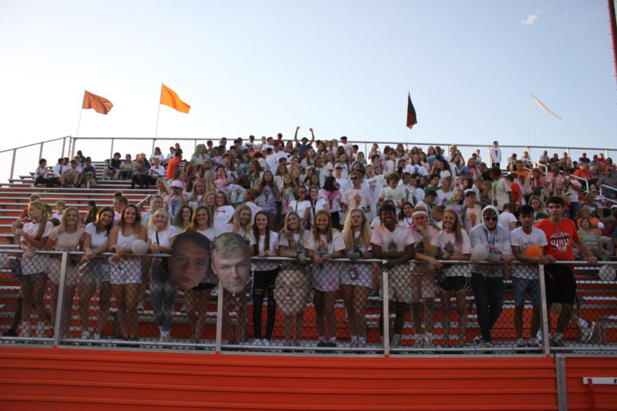 The student section supports the football players after participating in the white out.