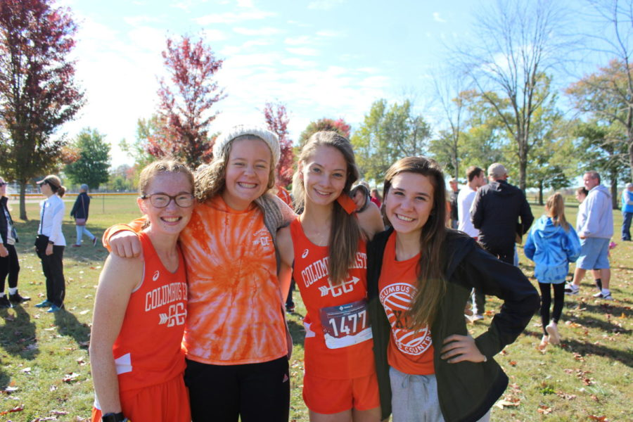 Sophomores Olivia Shoaf, Sammie Gilbert, Laurel Knight and Mallory Rupp get together for a photo after the varsity race.