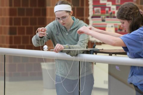 Concentrating on finding the precise location, junior Gloria Henrichsen prepares to drop her egg.
