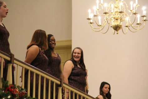 Sophomores Jianna Douglas and Isabelle Sully share a laugh as the audience applauds the performance.