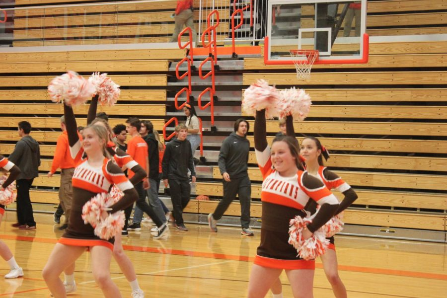 The cheerleaders attempt to get the audience pumped up.