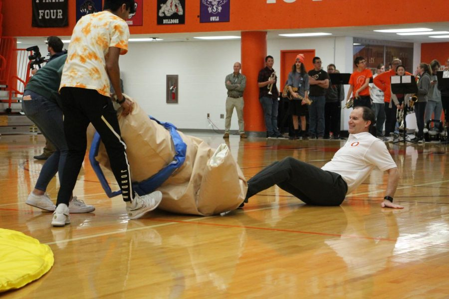 Junior Pranav Kumarasubramanian helps Principal Newell out of the sumo suit.
