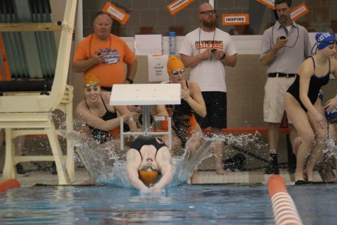 Sophomore Karissa Miller leaves the block into a backstroke.