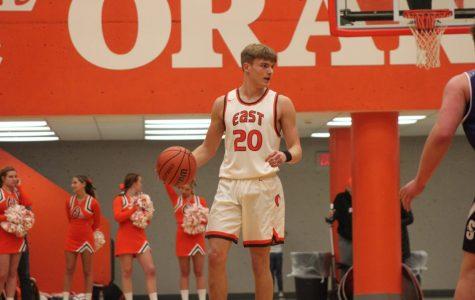 Junior Crase Bergman dribbles down the court.