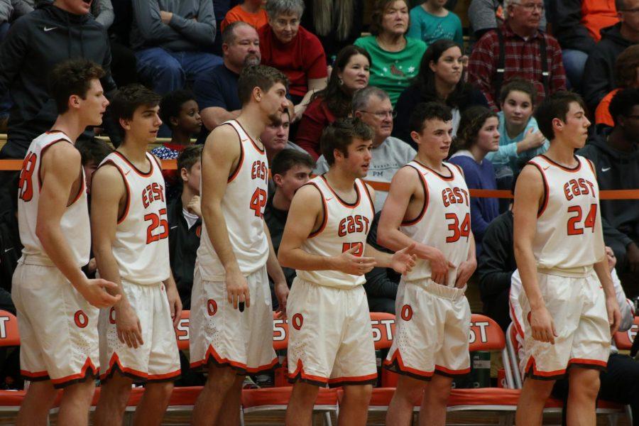 Junior Casey Bartholomew, Junior Elliot Koopman, Senior Seth Chandler, Senior Ben Khulman, Sophomore Will Rieckers and Junior Daniel Murphy cheer on their teammates from the bench.