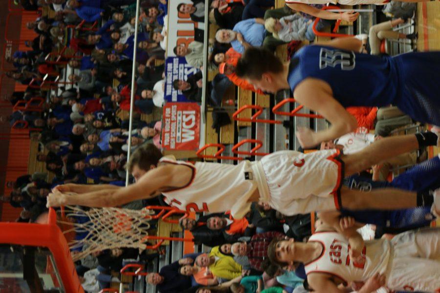 Senior Seth Chandler goes for the slam dunk.