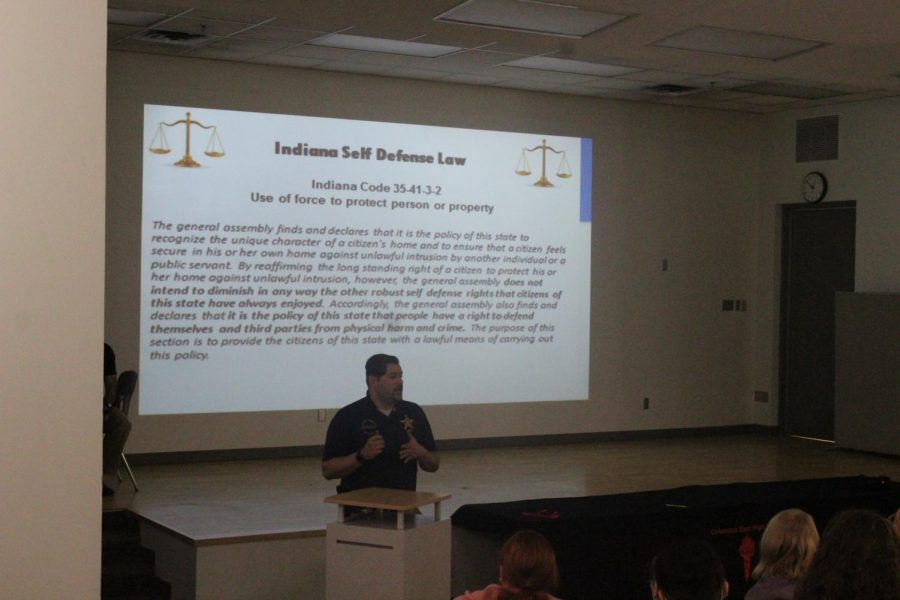 A Columbus police officer gives a presentation on self-defense laws in Indiana.