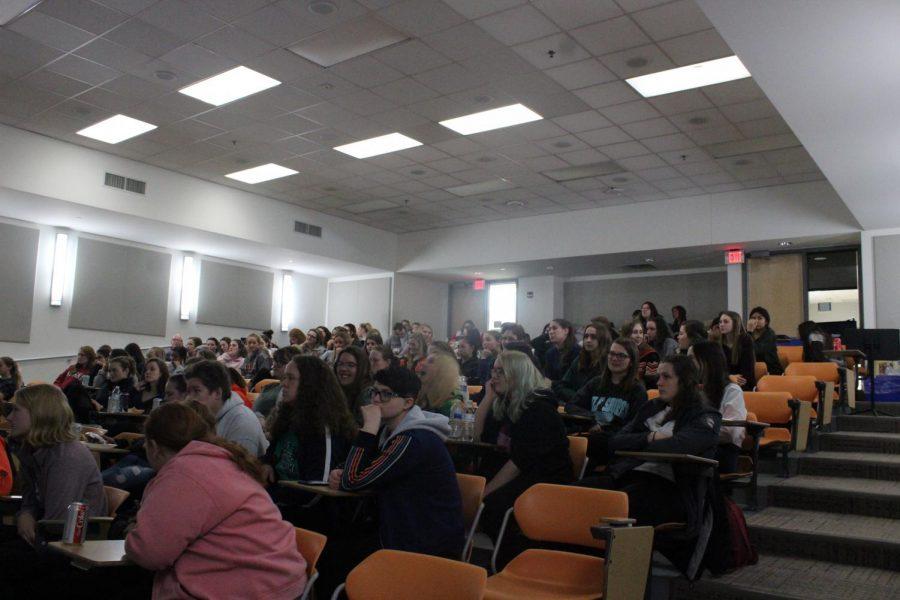 East senior girls wait for Self-Defense Day to start in room C104.