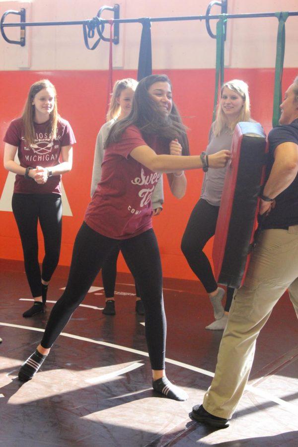Senior Allison Mack practices punching.