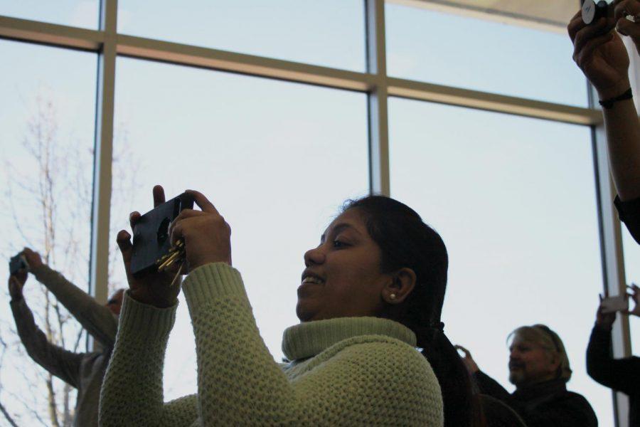 Science teacher Arpita Satsangi proudly takes a picture of the Academic Award receivers.