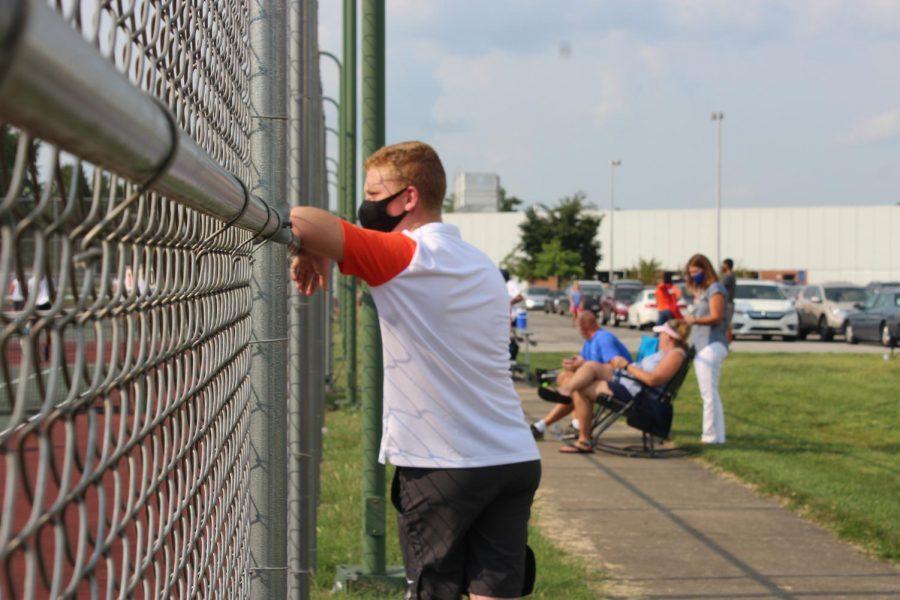 Freshman Jacob Dettmer watches the match.