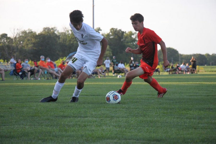 Junior Weston Romine challenges a defender.