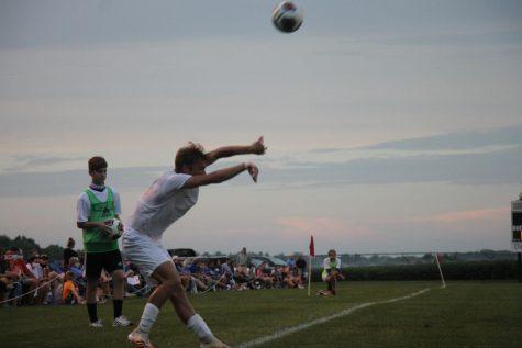 Senior Ben Romig throws in the ball