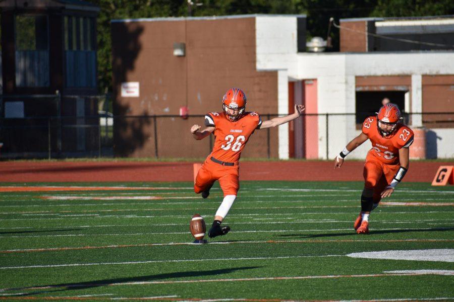 Sophomore Nathan Hedrick runs up for the kickoff.