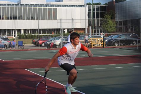 Sophomore Emmet Romine lunges for the ball.