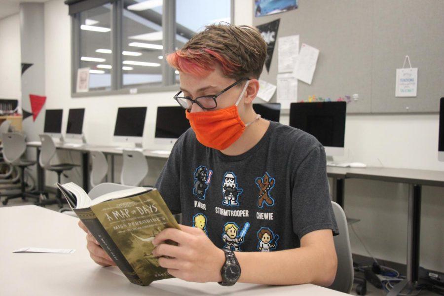 Freshman JR Hughes reads a book
