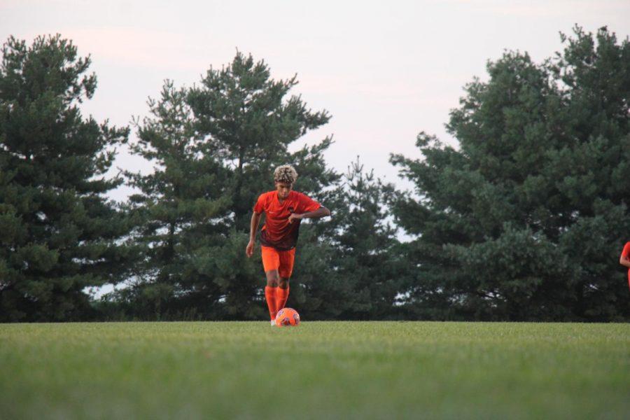 Junior Chris Quisenberry takes a free kick.