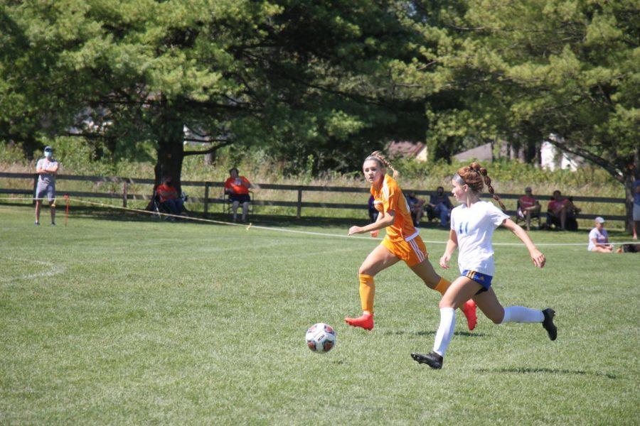 Senior+Hannah+Hemmerlein+defends+the+ball