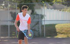 Sophomore Matthew Degner makes a serve.