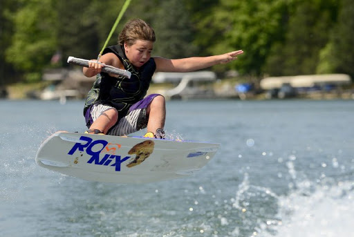 Kai Stidham, 9, takes to the air while wakeboarding Monday July 23, 2012, in preparation for the national championships in Ohio. (Joe Harpring | The Republic)  Joe Harpring | For The Republic