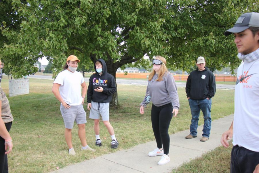 Senior Madison Miller practices walking in a straight line with drunk goggles.