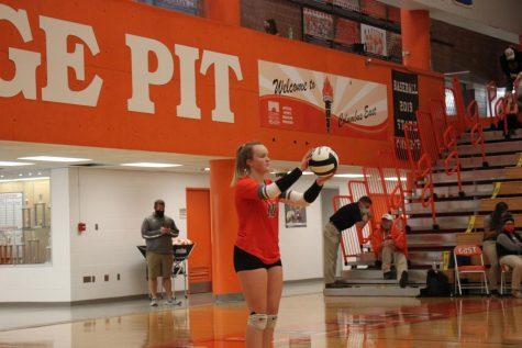 Junior Katy Jordan prepares to serve the ball.