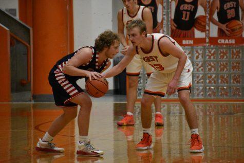 Senior Tyler Boyer locks down the defender.