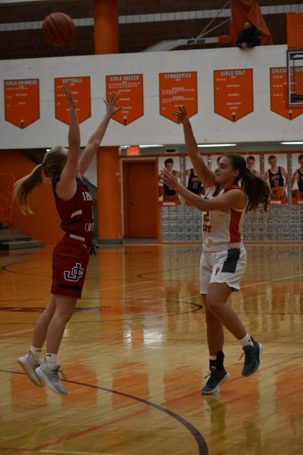 Junior Koryn Grewie lobs the ball to her teammate in the paint.