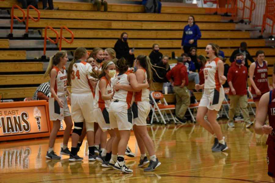 The East Women's Basketball team celebrates their big win.