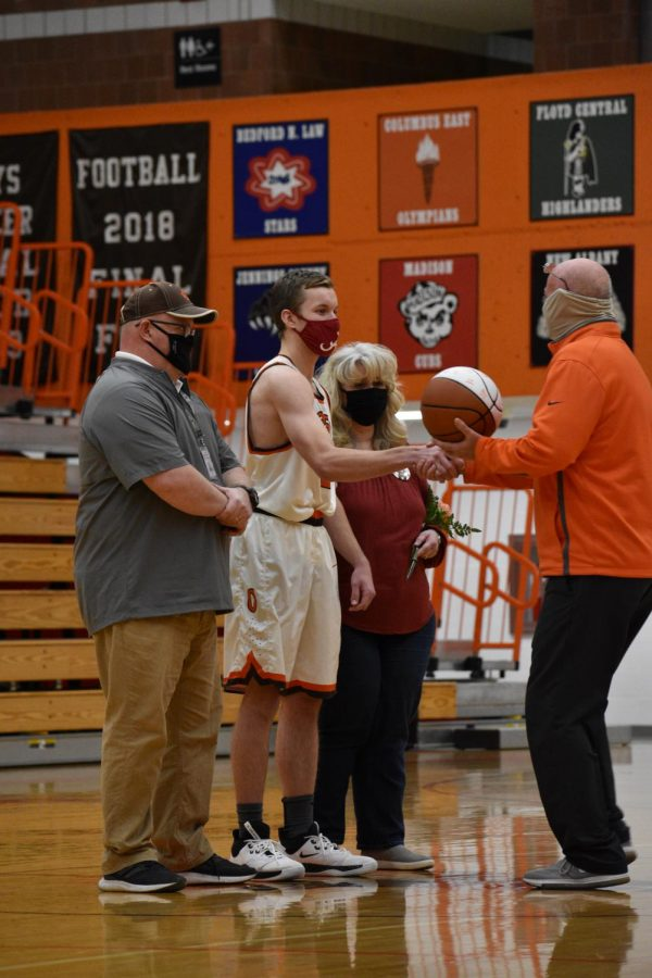 Senior Jacob Pierce and his family shake hands with Coach Chitty.