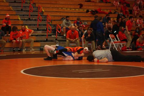 Junior Noah Lykins takes down opponent.