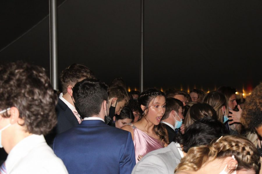 Senior Vanessa Brookes and friends dance at prom.