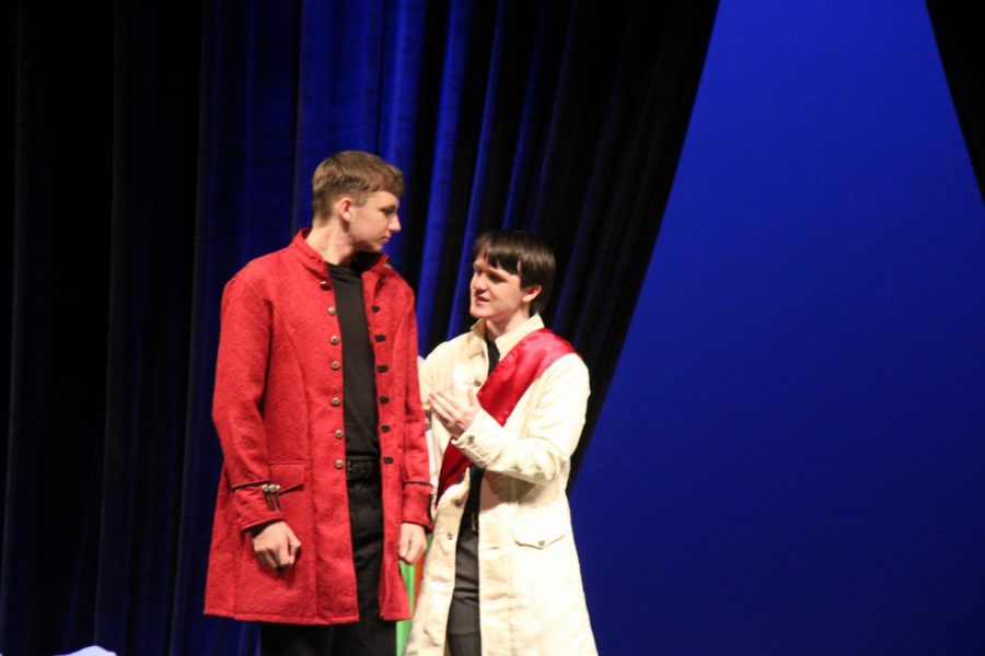 Sophomore jack burbrink and  junior Spencer Bright fight on stage as father and son.