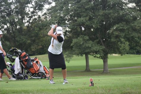 Sophomore Carter Gant takes a swing on hole eight.