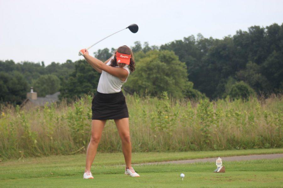 Sophomore Lilli Steinwedel swings on hole nine.