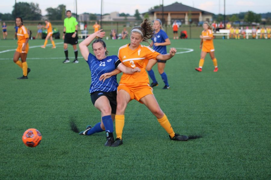 Junior Allison Craig fights to be first to the ball