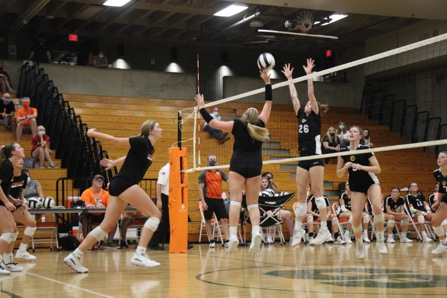 Players set up for a spike.