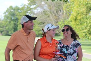 Senior Peyton Meier smiles with her parents.