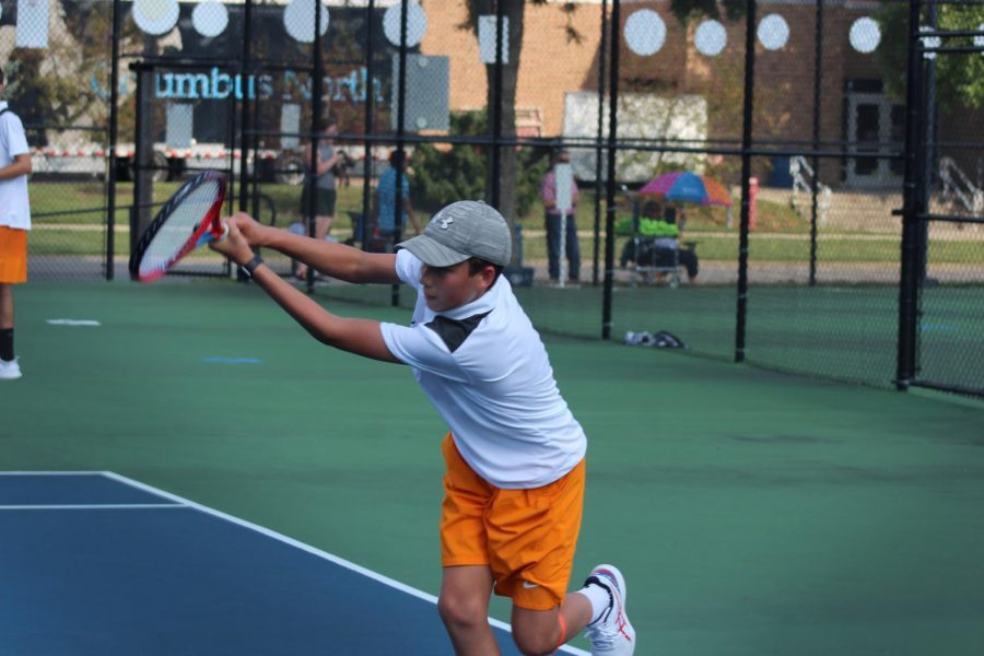 Sophomore Brady Redelman hits the ball to the opponent.
