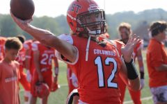 Columbus East quarterback, Ethan Duncan warms up for  the rivalry game.