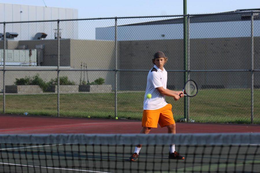 Freshman Ethan Bumbalough makes a hit.
