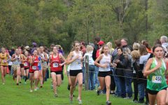 Senior Laurel Knight and sophomore Carly Otte stay side by side during the race